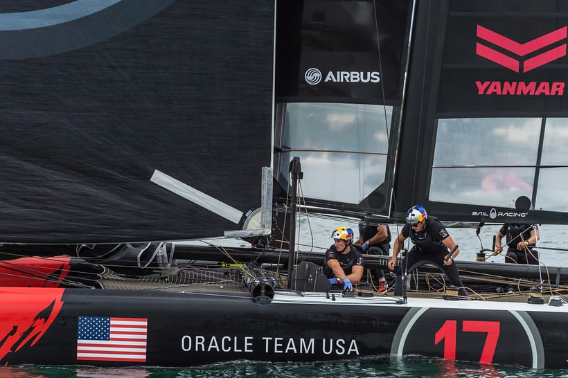 Look closely for red watch straps. The Oracle crew working the lines
