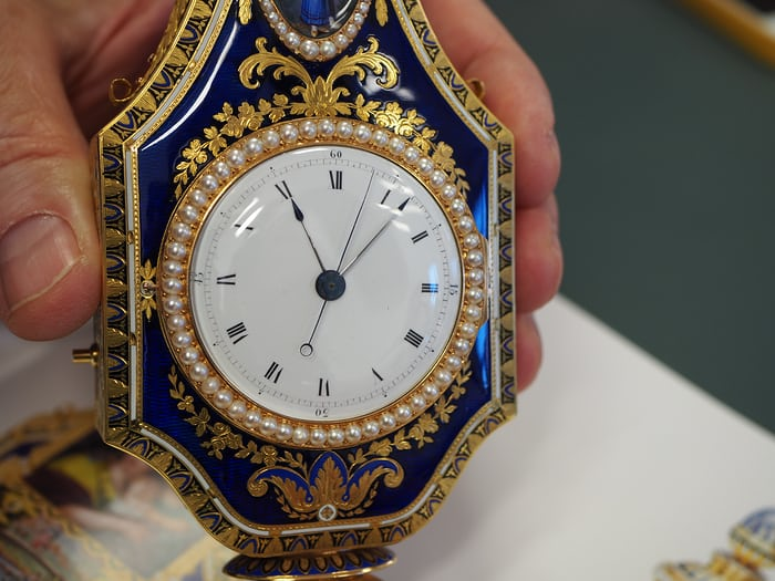 Perfume container / pocket watch / music box