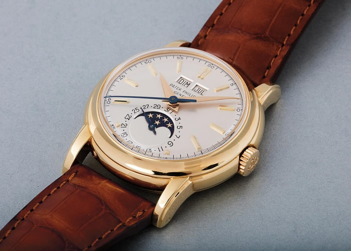 Lot 186 - PATEK PHILIPPE 2438/1, 18k yellow gold, 1954