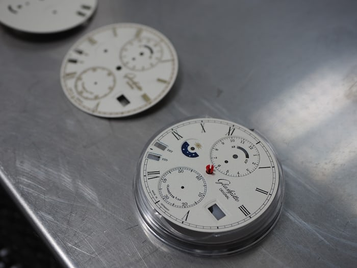 Dials at varying stages of completion