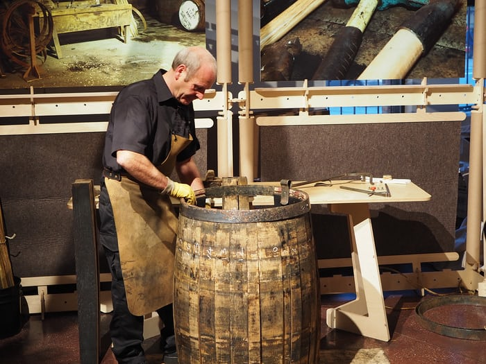 Ian McDonald, cooper, working on a barrel