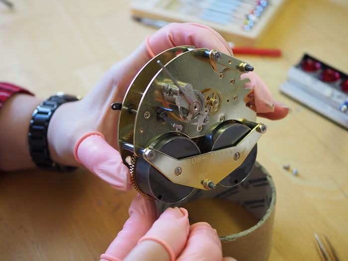Student working on a clock movement