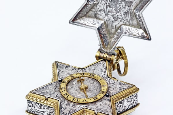 A tiny star-shaped watch, intricately engraved with scenes from the Bible. It was made c. 1630 by David Ramsay, appointed by King Charles I as the first Master of the Worshipful Company of Clockmakers in 1631.