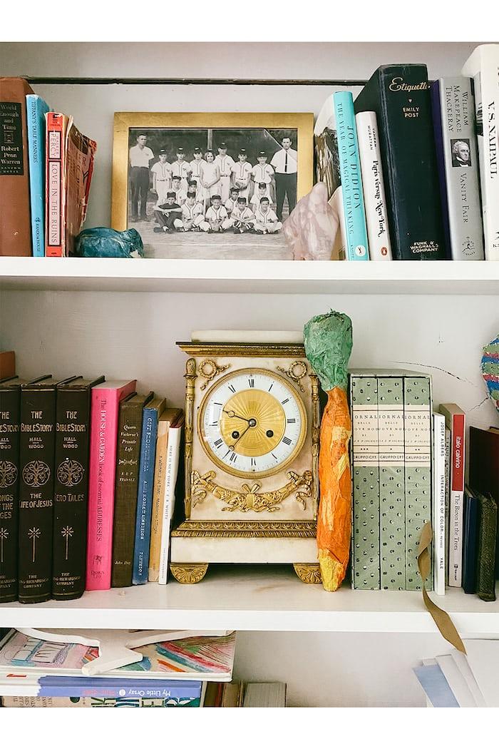 An antique clock on a shelf