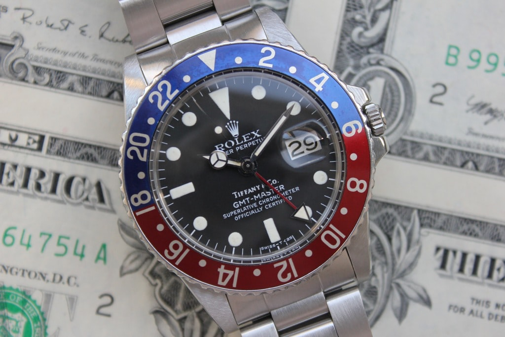 Rolex GMT Reference 1675, With Tiffany Dial Bring a Loupe: A Diverse Selection Ranging From A $500 Takano To A $25,000 Rolex GMT Retailed By Tiffany Bring a Loupe: A Diverse Selection Ranging From A $500 Takano To A $25,000 Rolex GMT Retailed By Tiffany Rolex 1675 hero