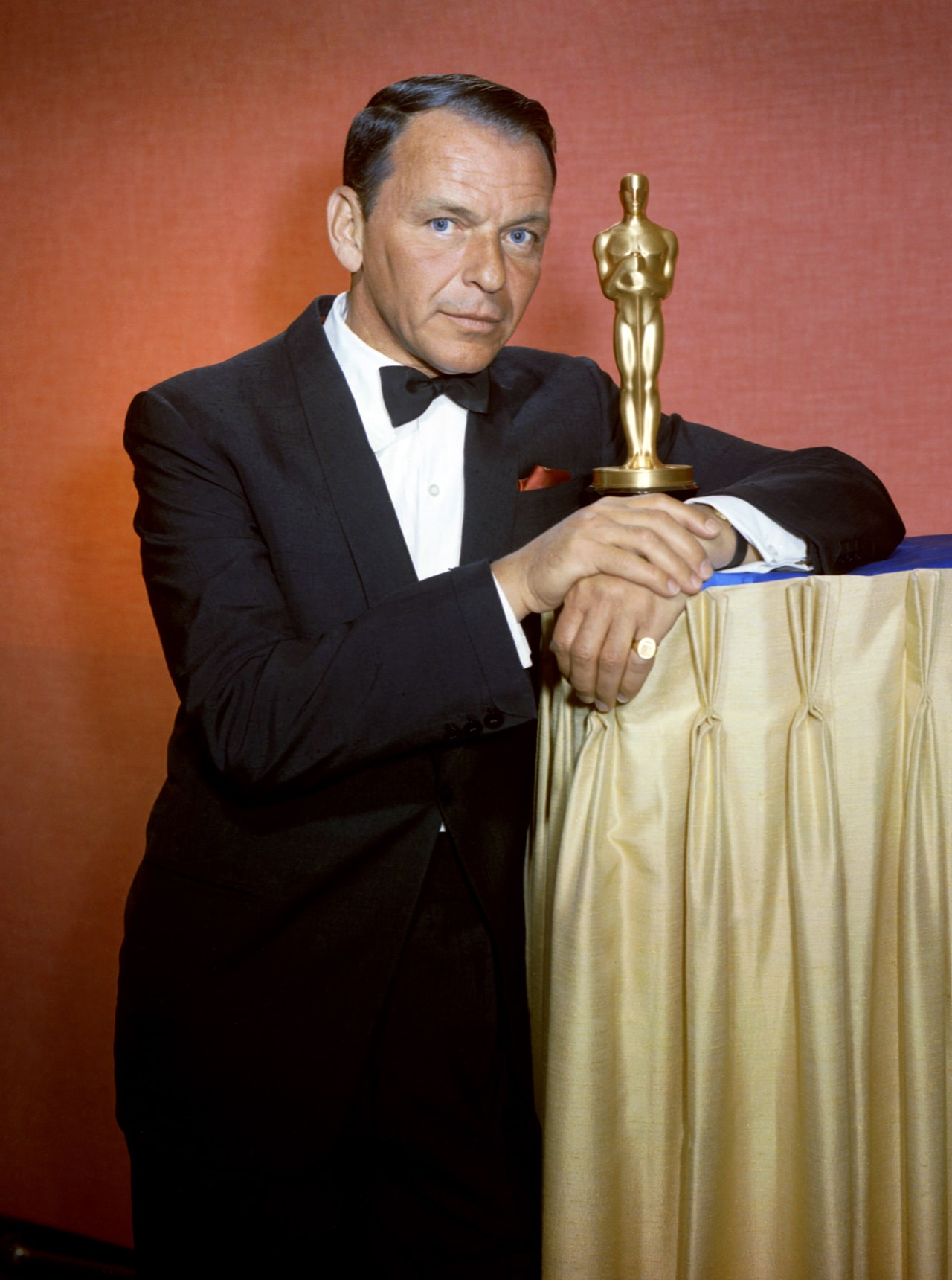 frank sinatra in black tie, with wristwatch