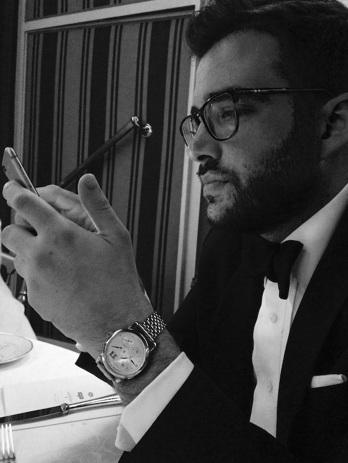 ben clymer in black tie with lange wristwatch