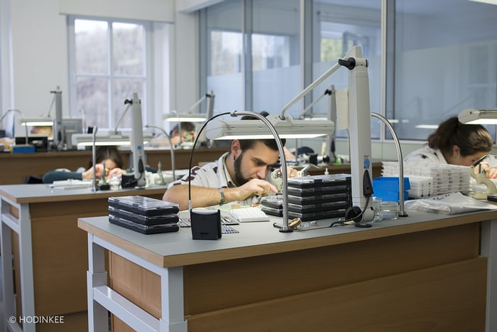 Watchmakers inside the NOMOS Glashütte manufacture