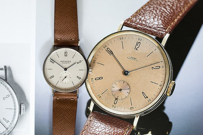 NOMOS Glashütte Tangent next to the watch that inspired it, a historical Lange