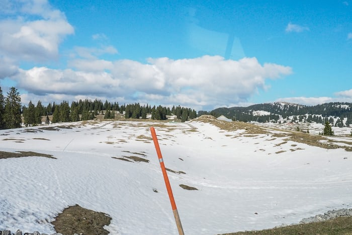 snow on the ground in April in the Swiss Jura
