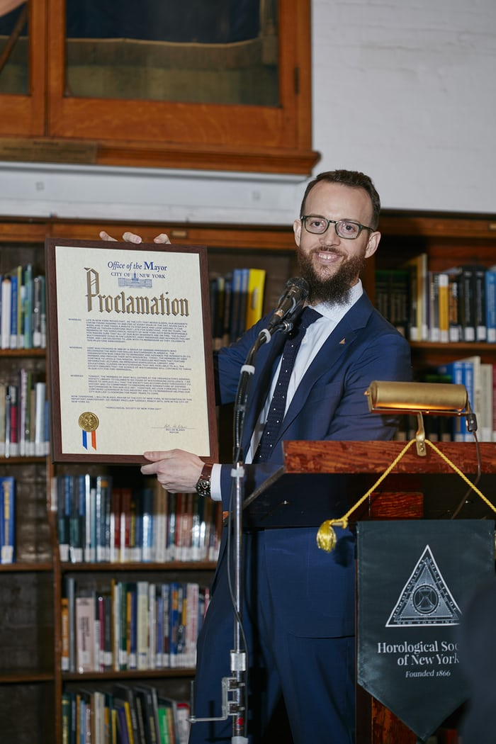 Nicholas Manousos, Vice President of HSNY, presenting a proclamation from New York City Mayor Bill de Blasio