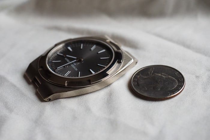 Vacheron Constantin Overseas Ultra-Thin next to a quarter