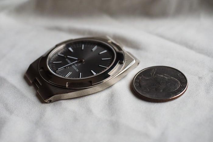 Vacheron Constantin Overseas Ultra-Thin next to a quarter