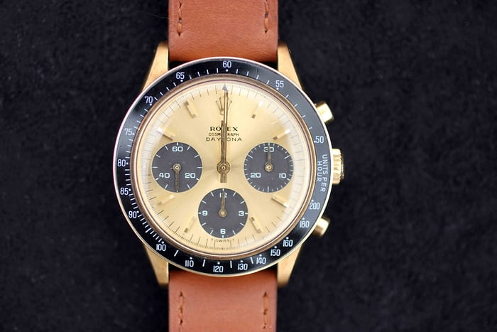 "Lot 111 - Rolex Cosmograph Daytona, ""The Copper-Tone"", 6241, 14k yellow gold, 1966"