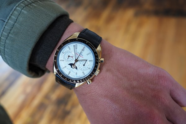 Omega Speedmaster Moonphase Master Chronometer Chronograph sedna gold wrist shot dial