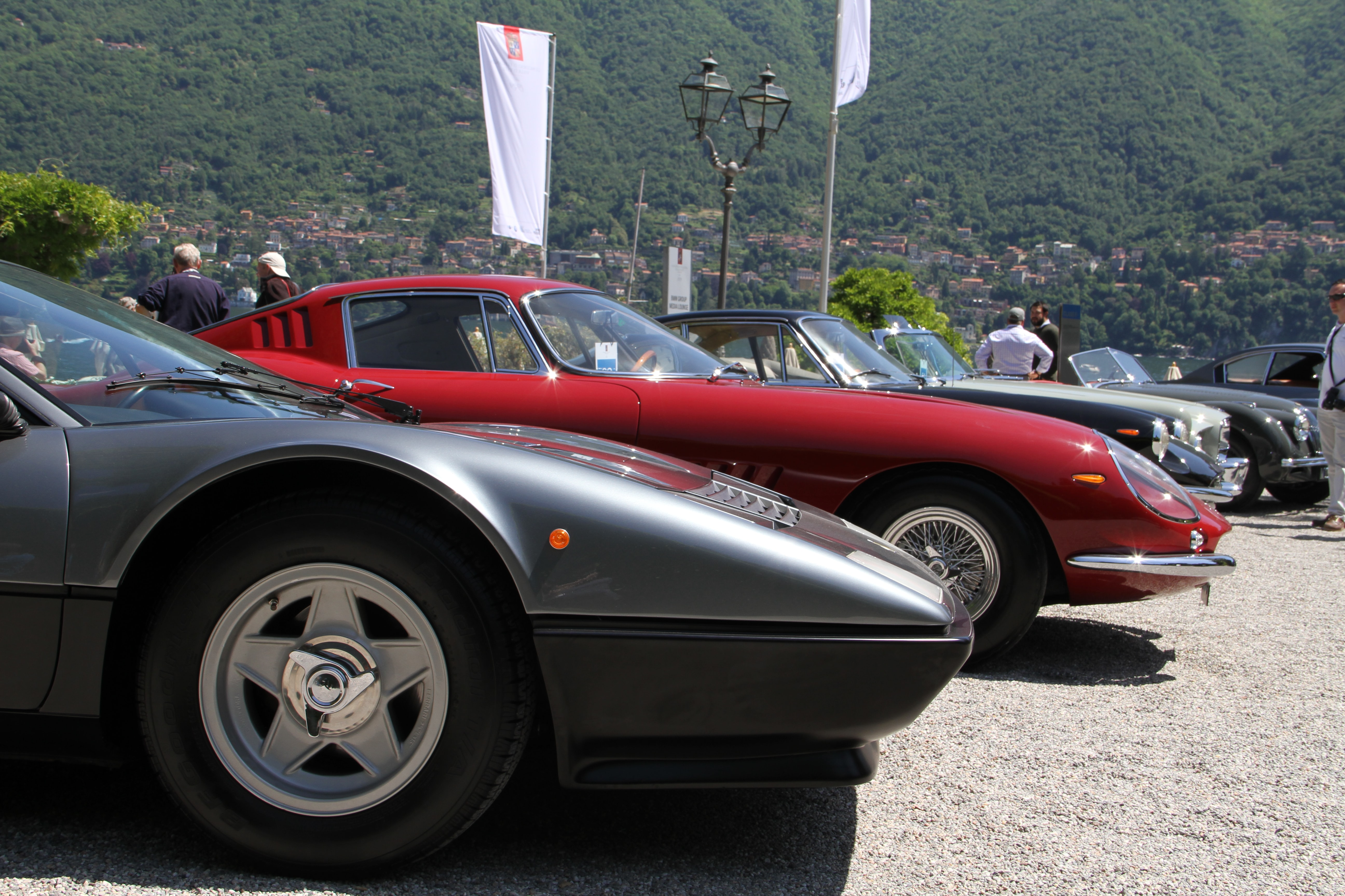 Ferrari 365 GBT/4 Berlinetta Boxer with Targa roof, formerly owned by Clint Eastwood, in front of a Ferrari 275 GTB/4 formely owned by Steve McQueen.  Photo Report: Watch And Car Spotting At The 2016 Concorso d'Eleganza Villa d'Este With A. Lange & Söhne Photo Report: Watch And Car Spotting At The 2016 Concorso d'Eleganza Villa d'Este With A. Lange & Söhne IMG 5314