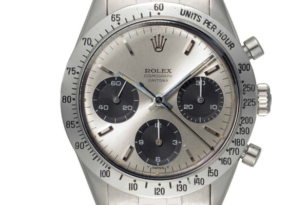 Lot 144 - Rolex 6239 Floating Daytona with white dial displaying a soleil finish.