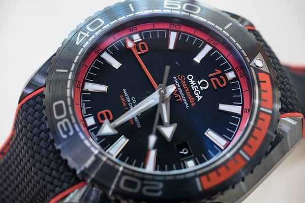 planet ocean deep black red dial closeup