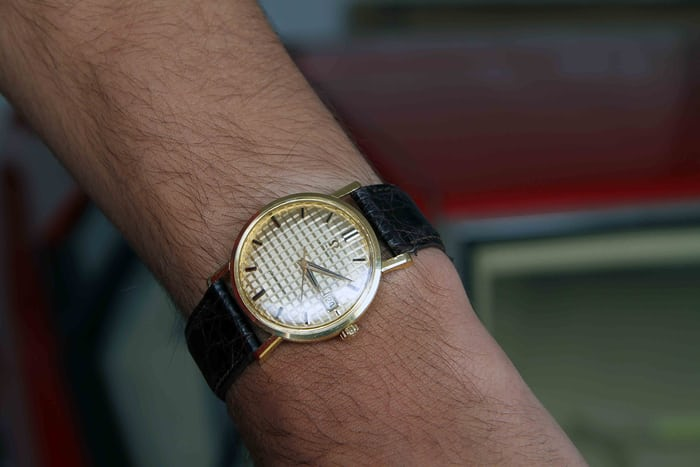 Omega Seamaster with waffle dial in 18K yellow gold.