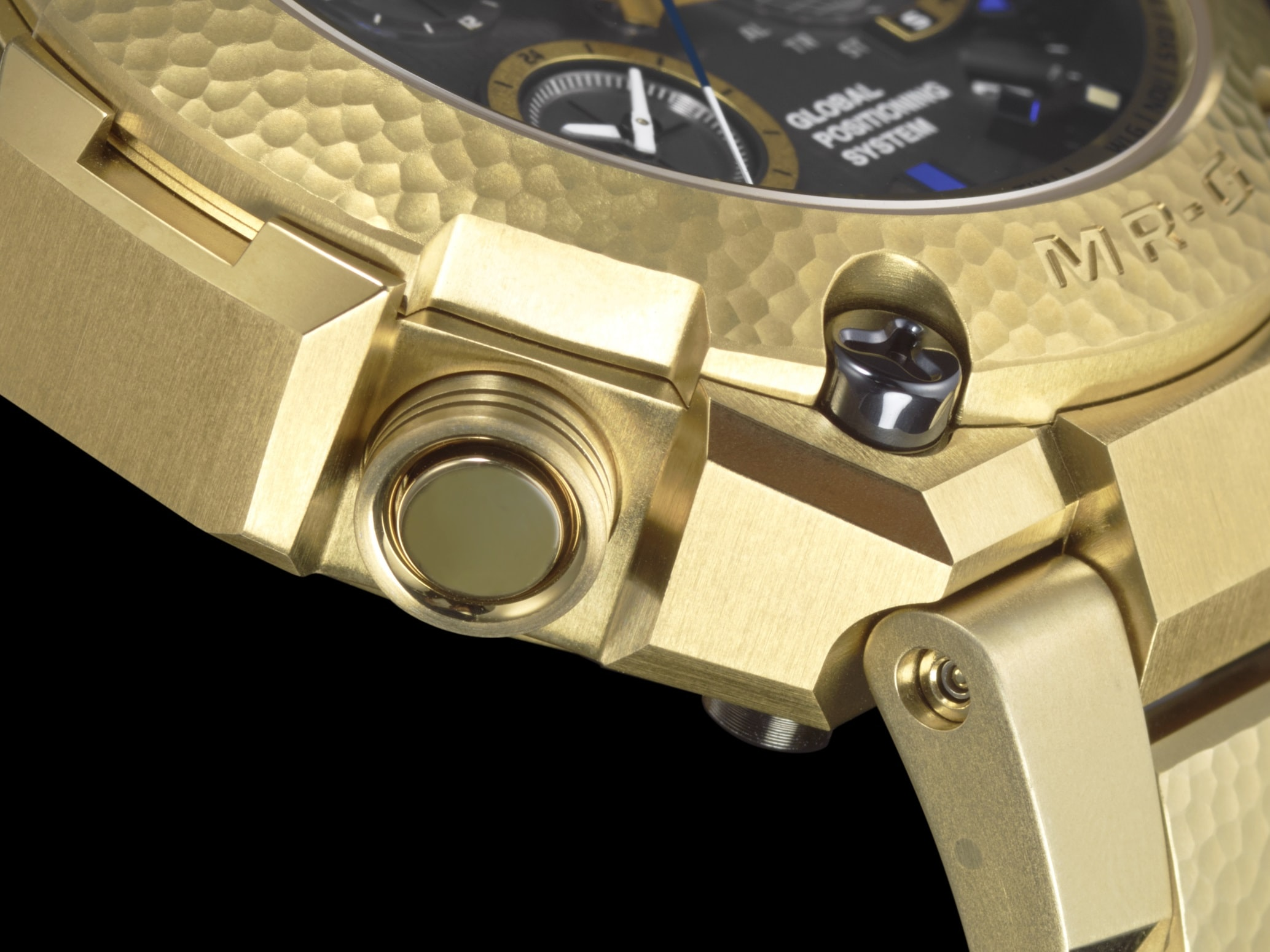 MRG-G10000HG-9A bezel Introducing: The Casio G-Shock 'Hammer Tone' MRG-G10000HG-9A In Gold, Celebrating 20 Years Of MR-G Introducing: The Casio G-Shock 'Hammer Tone' MRG-G10000HG-9A In Gold, Celebrating 20 Years Of MR-G MRG G1000HG 9A theme 4