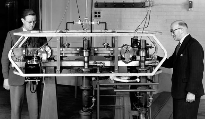 The first cesium beam atomic clock, with inventors Louis Essen and Jack Parry, 1955. National Physics Laboratory, UK.