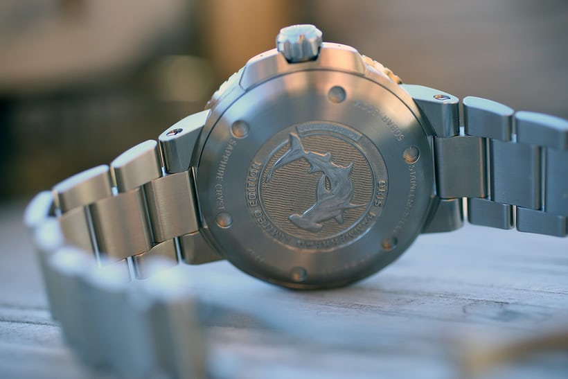 The stainless steel case back is embossed with a Hammerhead shark.
