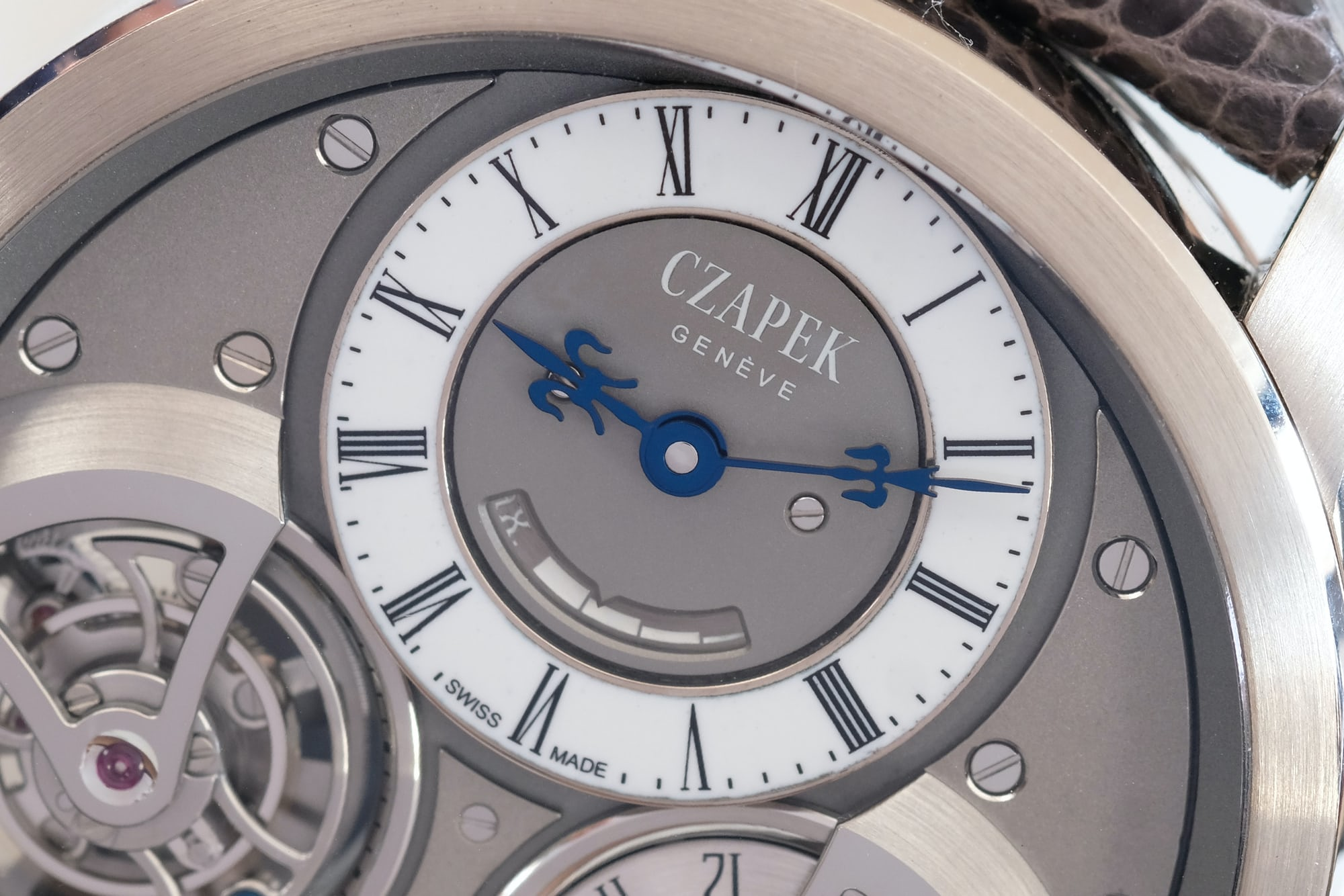 <p>The grand feu enamel dial, with power reserve indicator.</p>