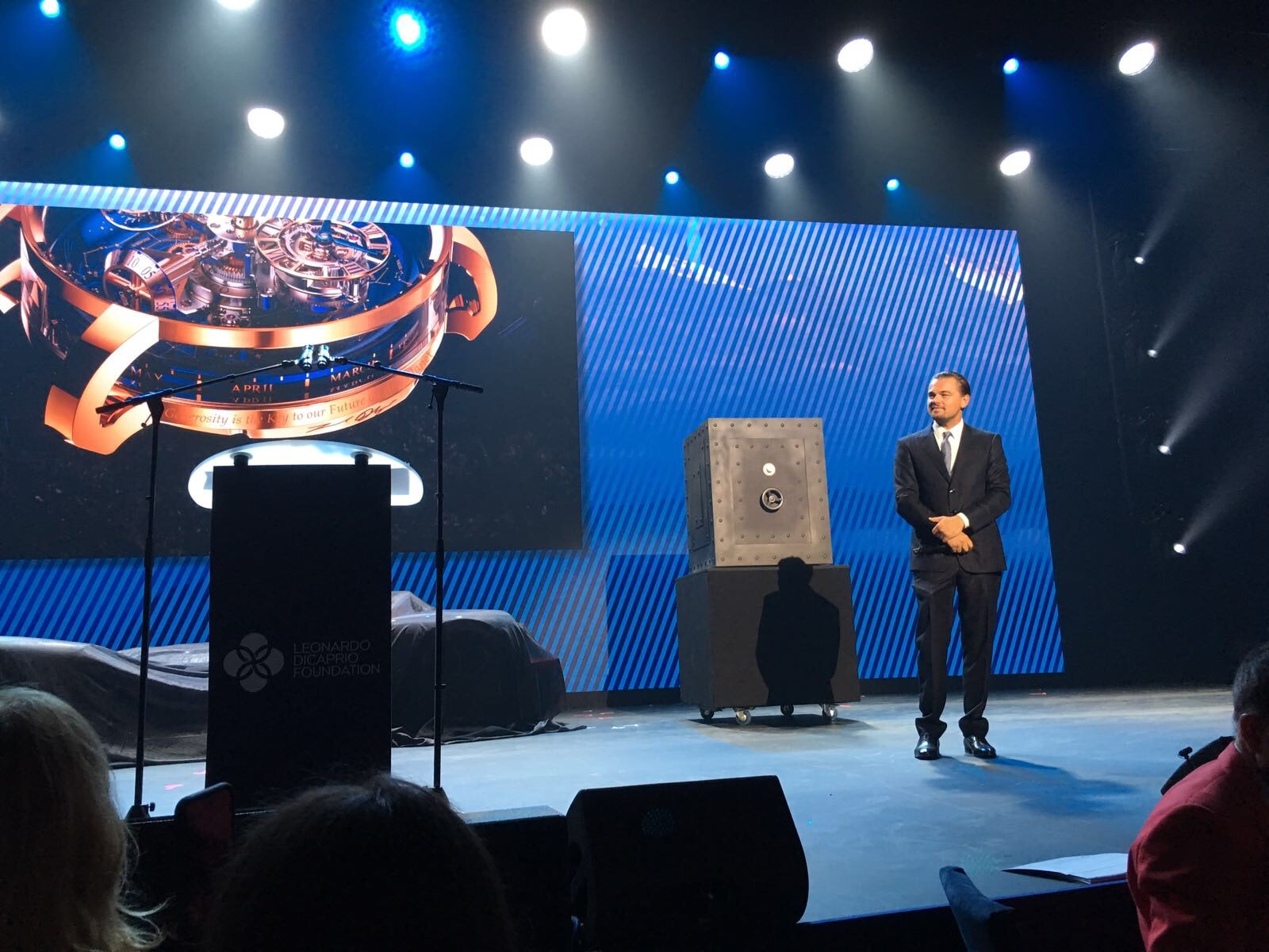 Leonardo DiCaprio on stage with the Astronomia Sky.  Auction Report: Jacob & Co. Astronomia Sky Unique Piece Sold At Leonardo DiCaprio Foundation Benefit In St. Tropez (For An Undisclosed Amount) LD Jacob Watch Stage