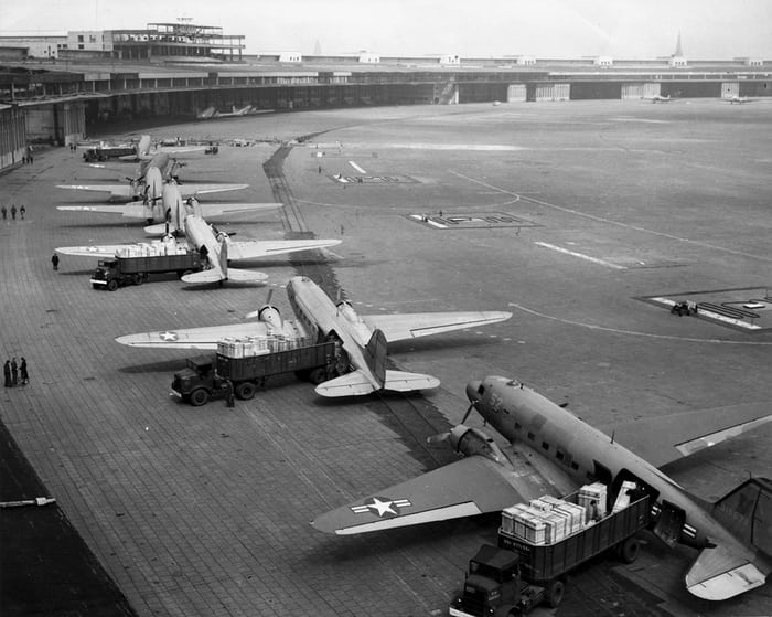 Douglas C-47s unloading supplies at Tempelhof, Berlin, in 1948, during Berlin Airlift. Phot, US Navy National Museum of Naval Aviation.