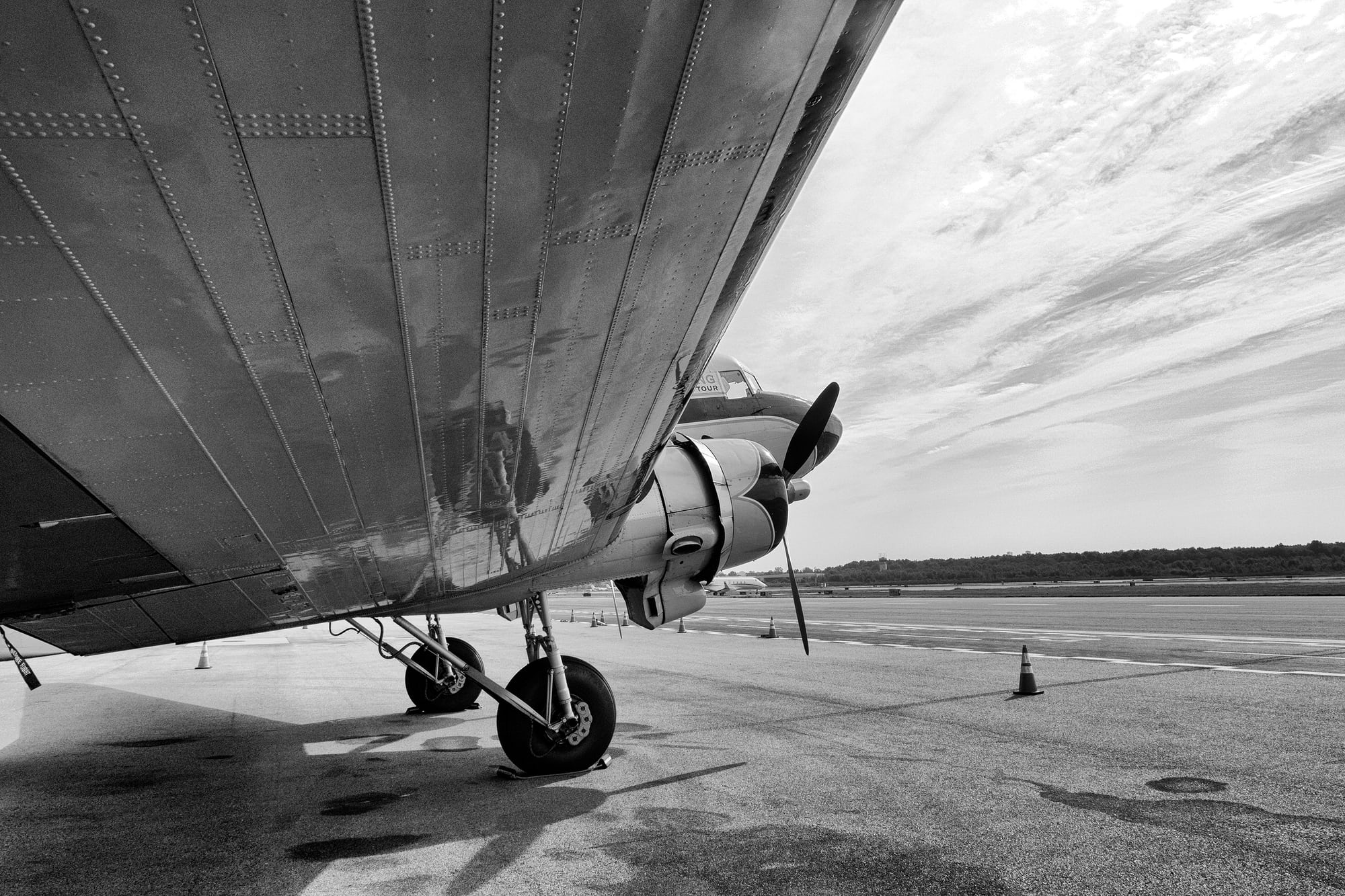 Breitling DC-3 wing and landing gear Dispatches: Breitling's DC-3 To Become Oldest Aircraft Ever To Circle The Earth Dispatches: Breitling's DC-3 To Become Oldest Aircraft Ever To Circle The Earth P8212240 bw