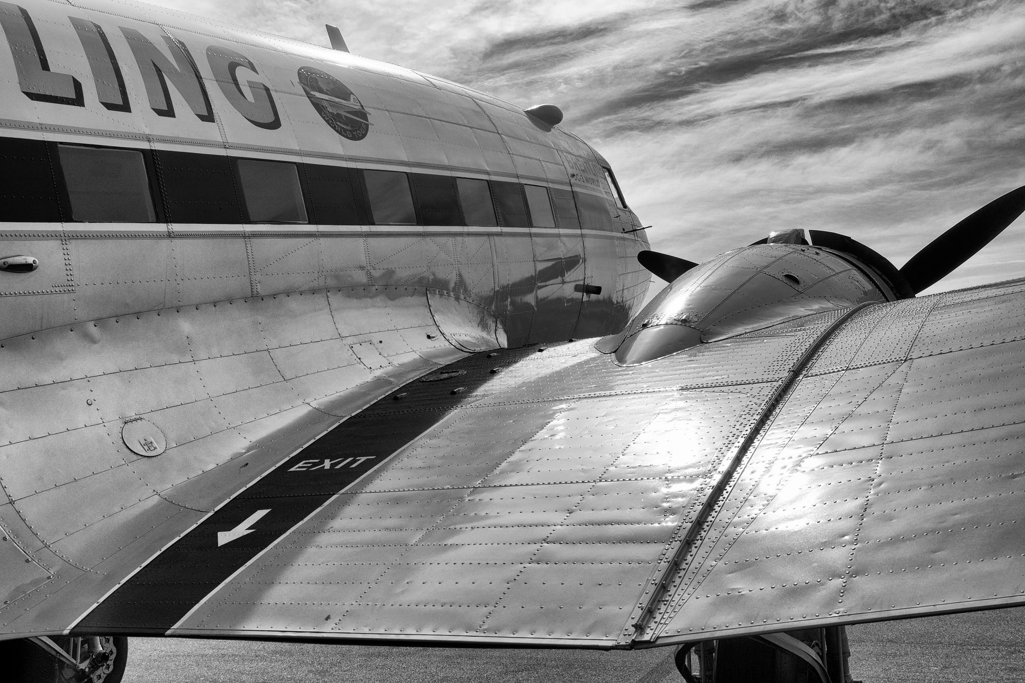 Breitling DC-3 wing root Dispatches: Breitling's DC-3 To Become Oldest Aircraft Ever To Circle The Earth Dispatches: Breitling's DC-3 To Become Oldest Aircraft Ever To Circle The Earth P8212246 bw