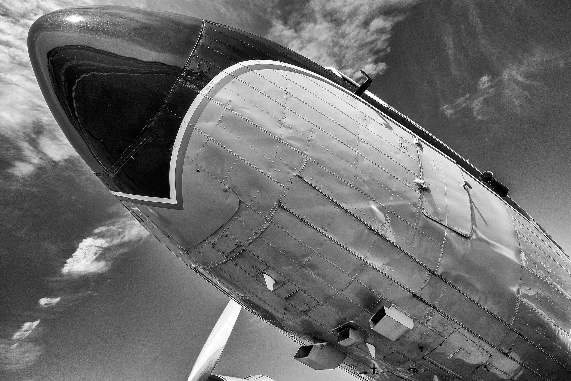 Breitling DC-3 fuselage Dispatches: Breitling's DC-3 To Become Oldest Aircraft Ever To Circle The Earth Dispatches: Breitling's DC-3 To Become Oldest Aircraft Ever To Circle The Earth P8212270 bw