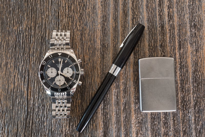tag heuer autavia with vintage pen and lighter