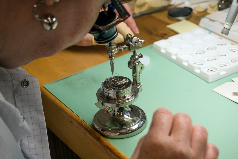 vibrating a balance spring by hand at Minerva Montblanc