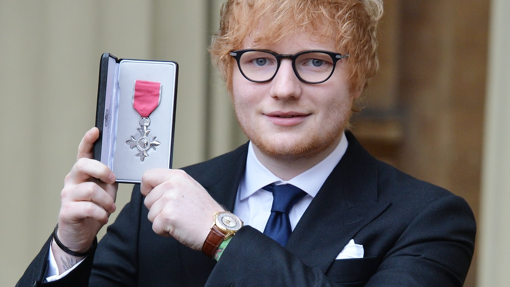 Watch spotting ed sheeran wearing a patek philippe reference 5130r while receiving an mbe for Celebrity tissot watch