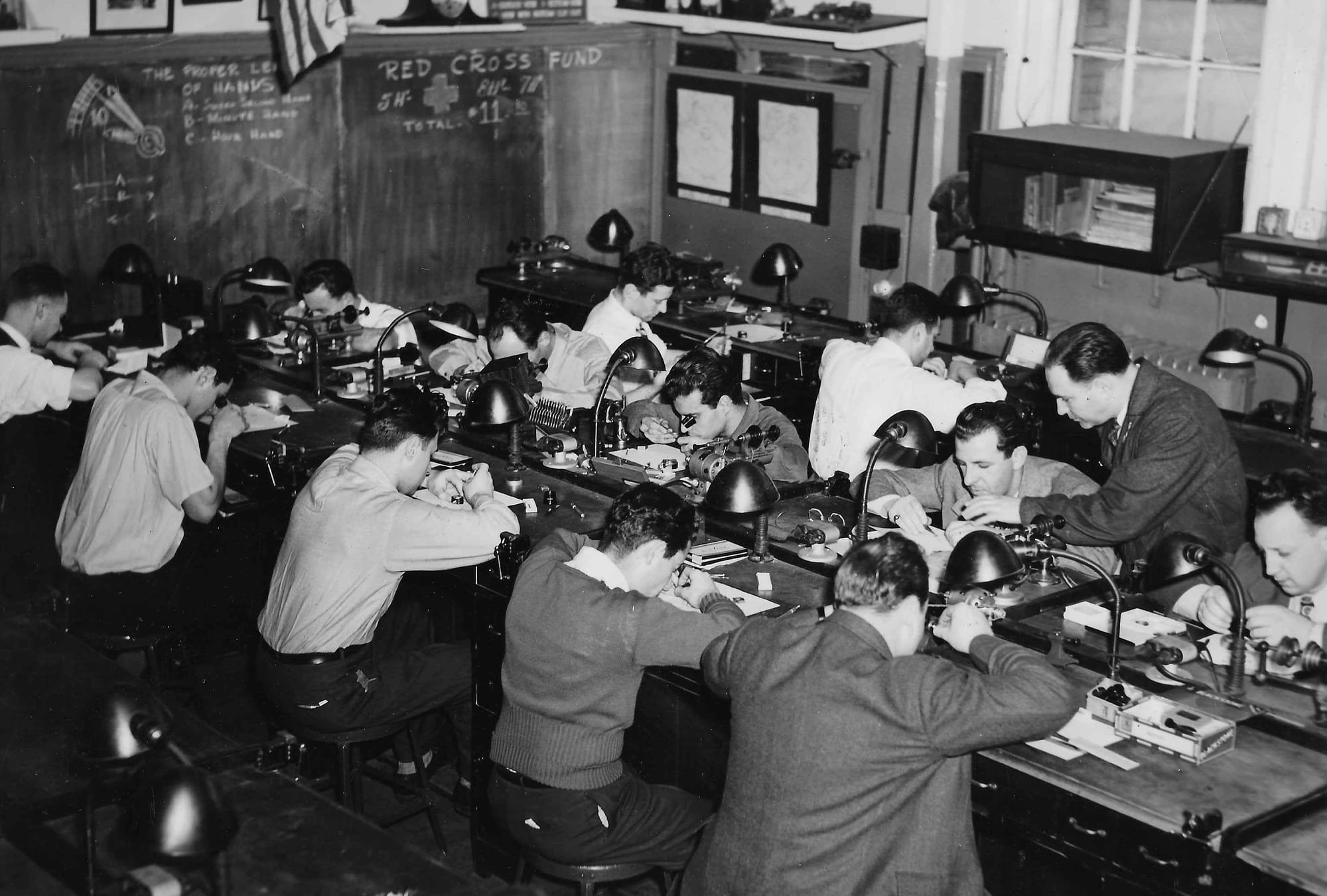 Henry B. Fried instructing a watchmaking class.