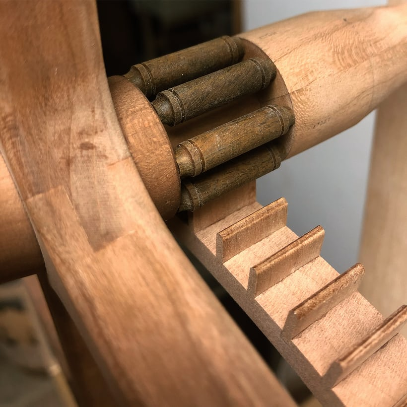 Lantern pinion with lignum vitae rollers