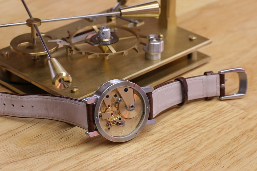 Brivet-Naudot's Eccentricity, resting on a model of the libre excentrique escapement.