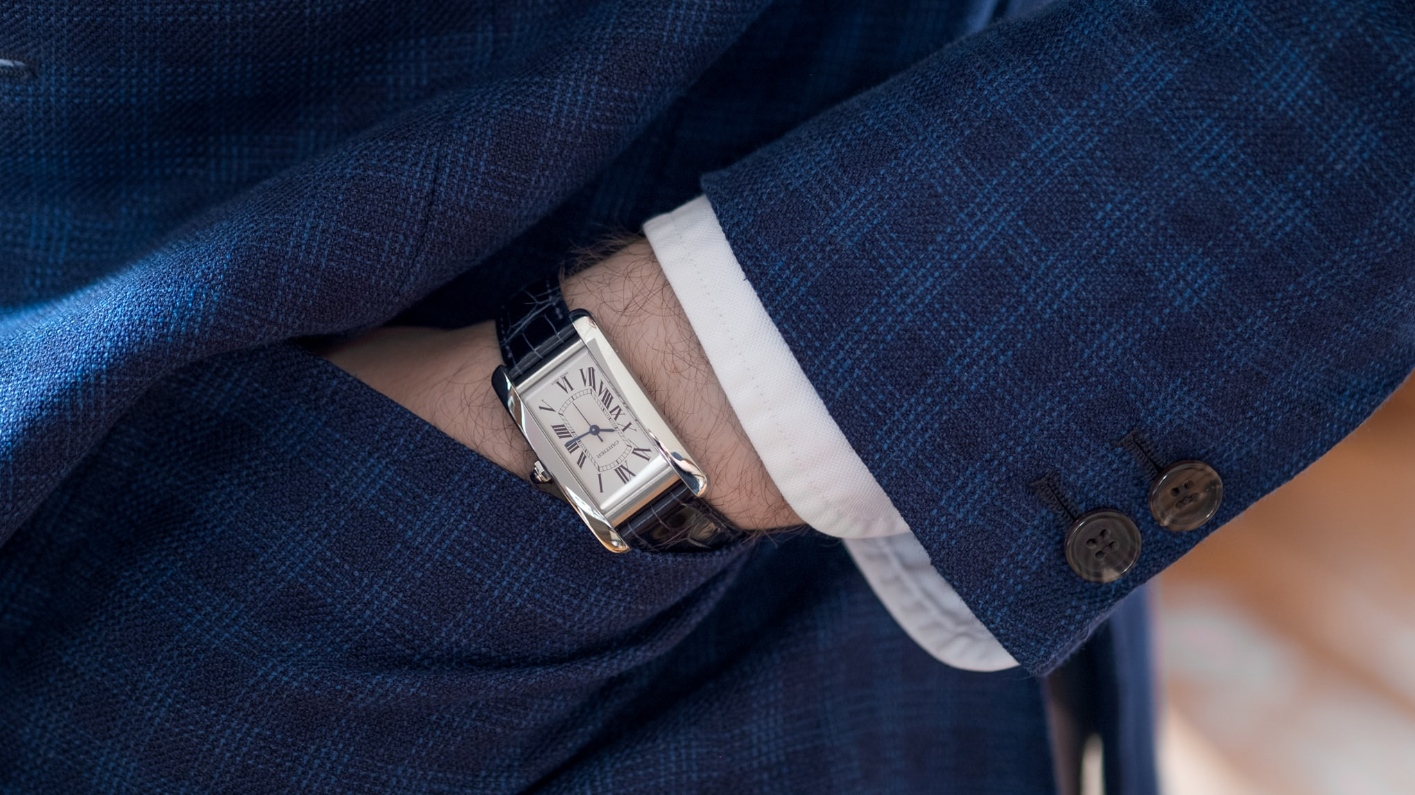 Recommended Reading: It Turns Out That Men Wearing Watches That Don't Tell The Time Is Now A Thing cartier tank 20 hero