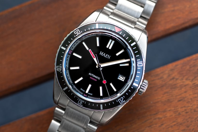 ee061115f621 38mm wide with a black sandblast-finished dial and red accents.