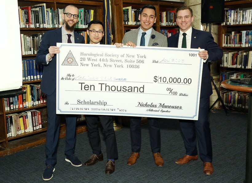 Nicholas Manousos (HSNY's President, left) and Steve Eagle (HSNY's Director of Education, right) presenting the 2018 Henry B. Fried Scholarship to Mark Duckett (middle left) and Erik Gonzalez (middle right), students at the Patek Philippe New York School