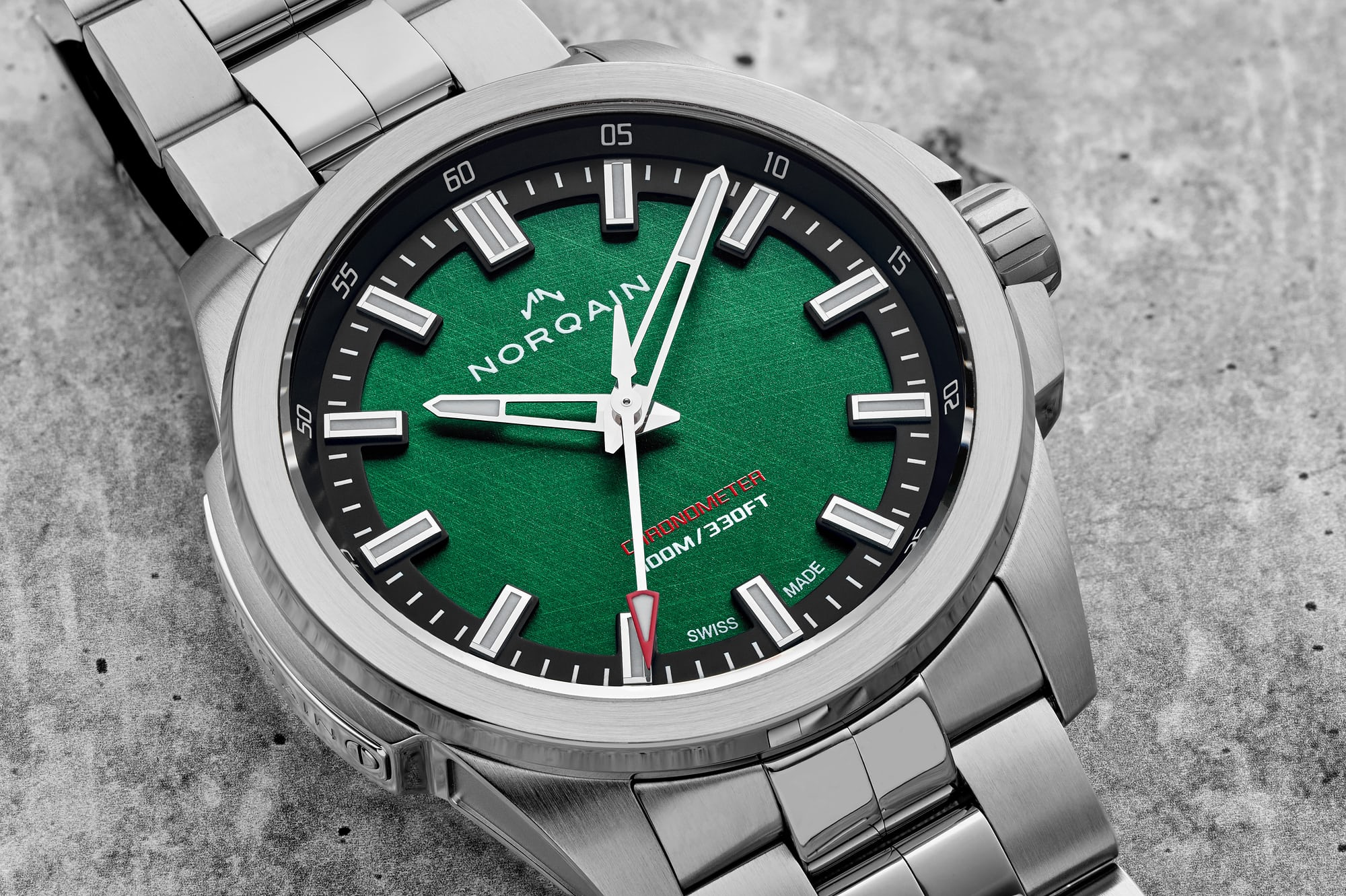 """<p><a href=""""https://shop.hodinkee.com/products/norqain-independence-20-scratched-forest-green-dial-bracelet-limited-edition?_pos=1&amp;_sid=921a1296f&amp;_ss=r&amp;variant=32700298035275"""" rel=""""noopener"""" target=""""_blank""""><u>NORQAIN Independence 20</u></a></p>"""