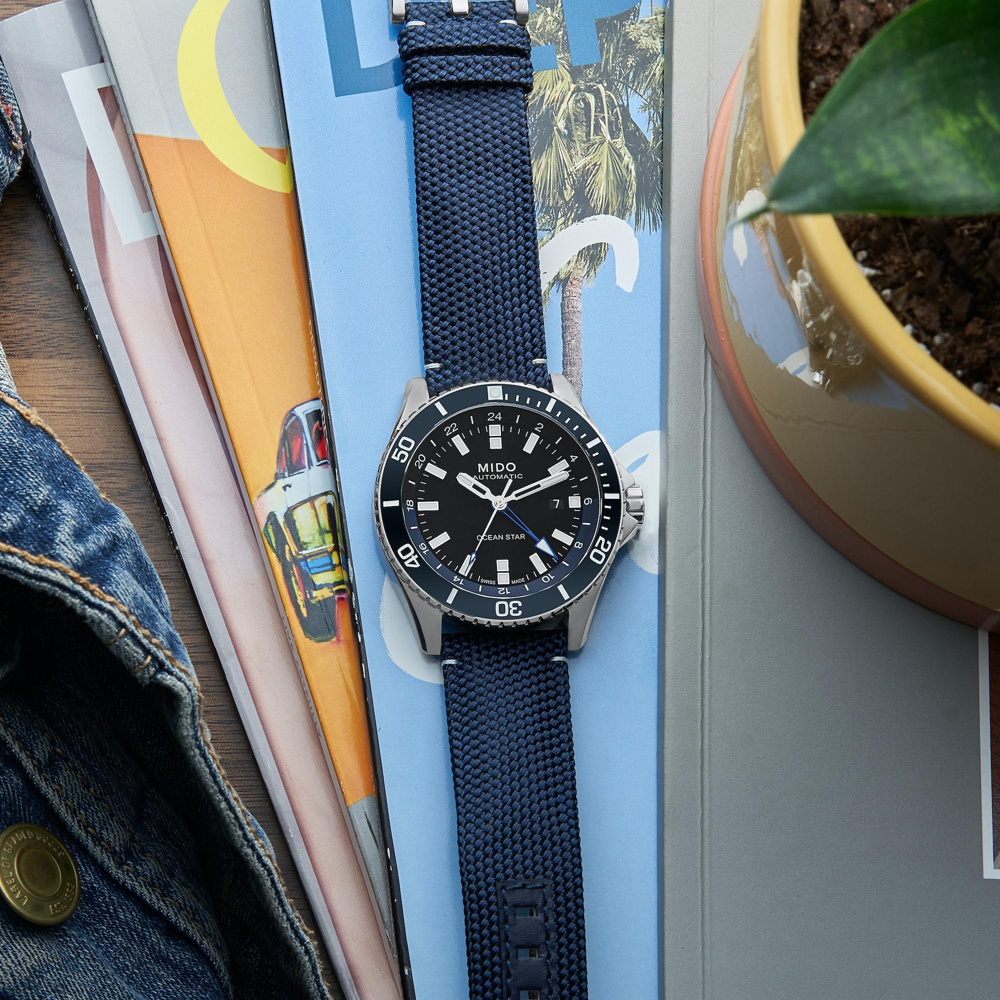 "<p><a href=""https://shop.hodinkee.com/products/mido-ocean-star-gmt-black-dial-blue-strap?_pos=2&amp;_sid=389582b2e&amp;_ss=r&amp;variant=32790424682571"" rel=""noopener"" target=""_blank""><u>Mido Ocean Star GMT</u></a></p>"