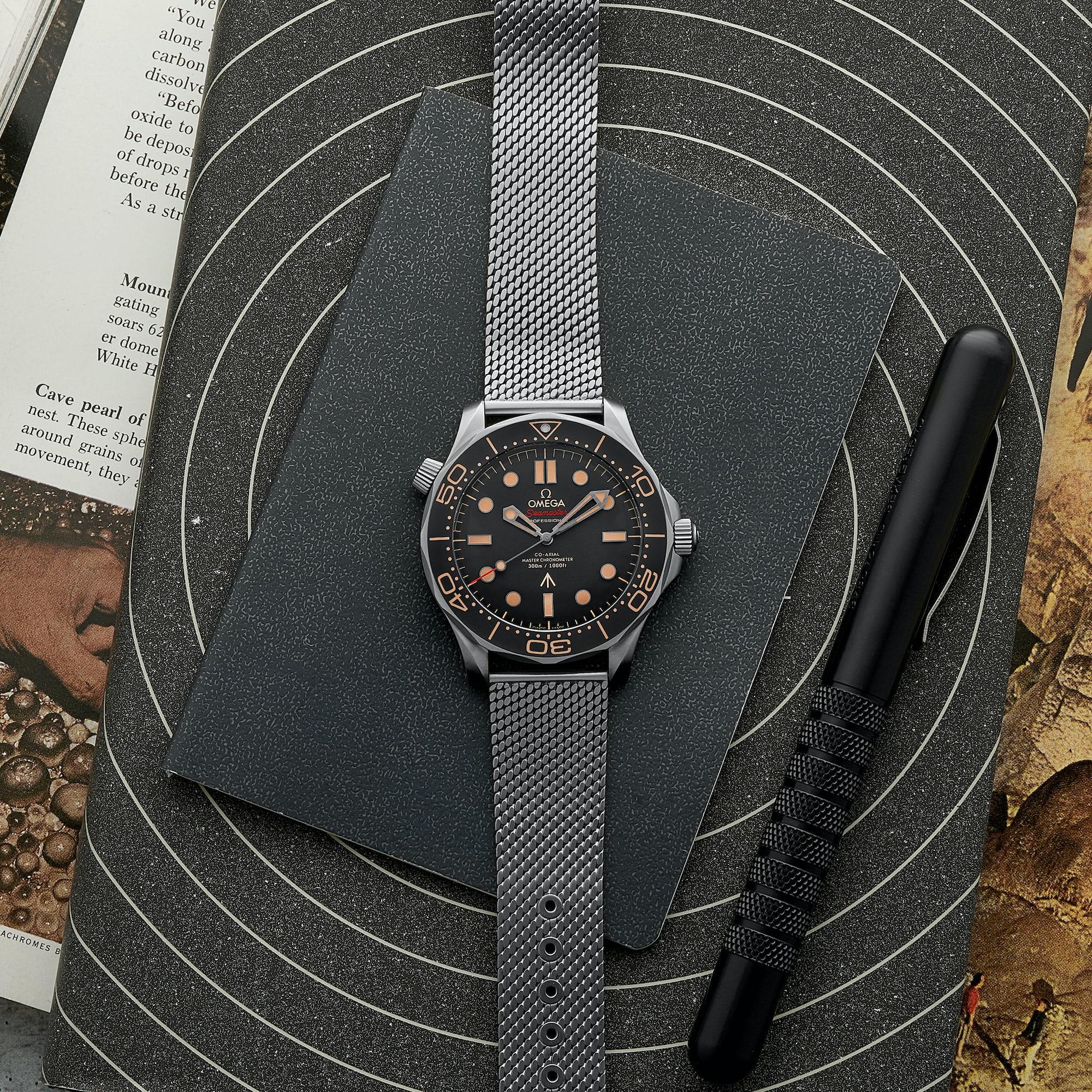 "<p><a href=""https://shop.hodinkee.com/collections/omega/products/omega-seamaster-diver-300m-co-axial-master-chronometer-42mm-titanium-007-edition-bracelet?variant=31745136623691"" rel=""noopener"" target=""_blank""><u>OMEGA Seamaster Diver 300M Co-Axial Master Chronometer 42mm Titanium 007 Edition</u></a></p>"