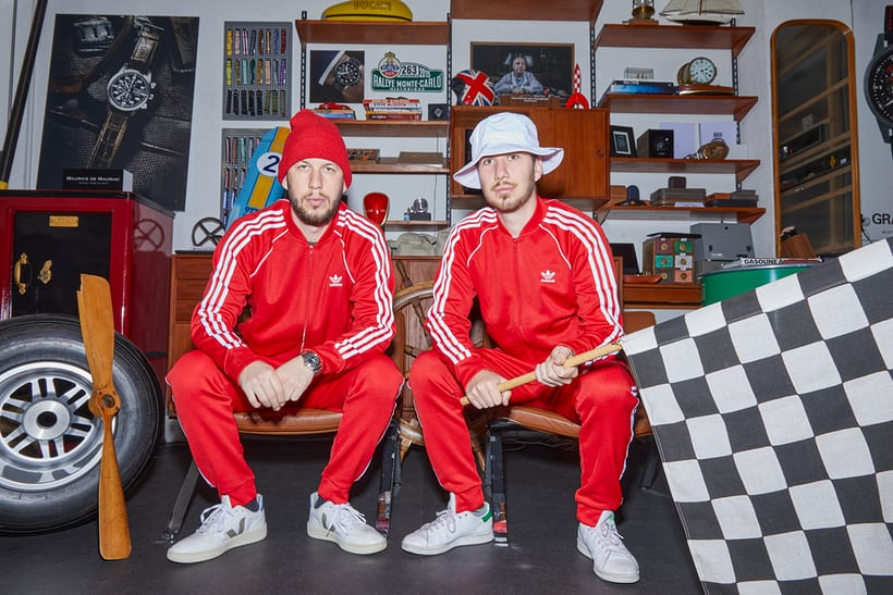 two men in red track suits