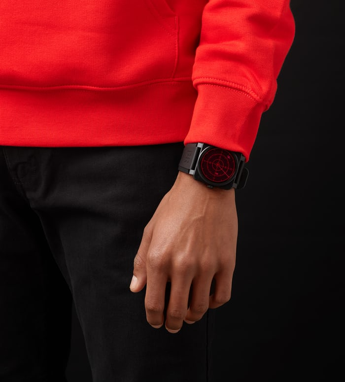 A person in a red sweatshirt wearing a Bell-Ross watch