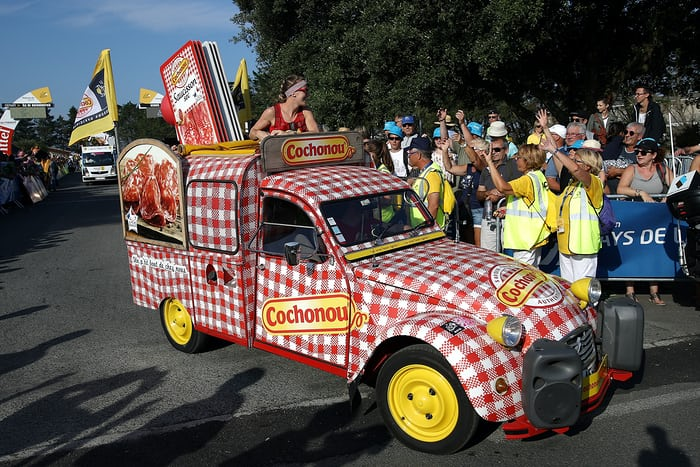 A checkered sausage truck