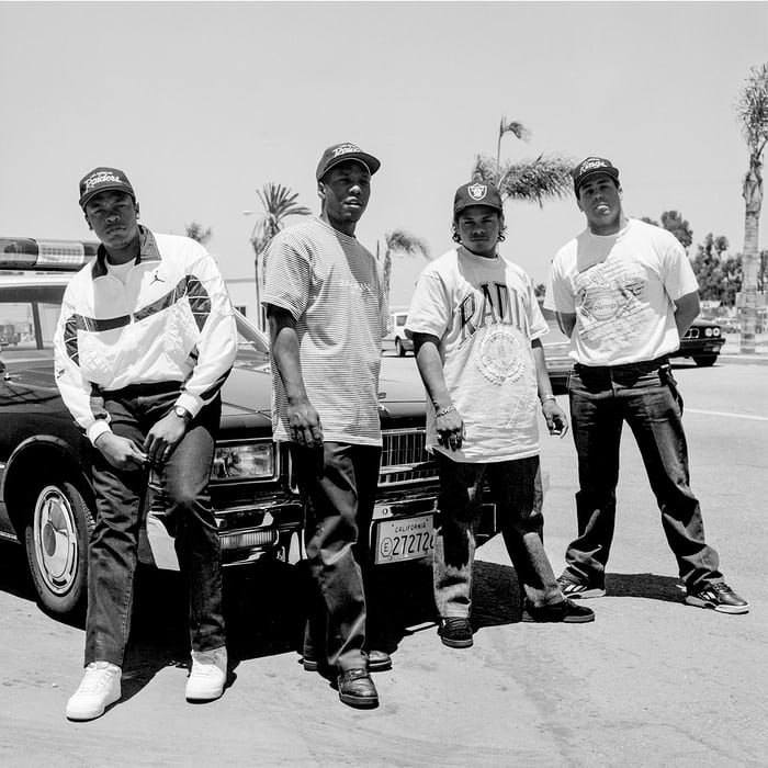 N.W.A. posing in front of a car