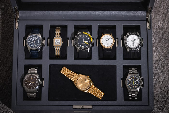 A gold rolex and other watches