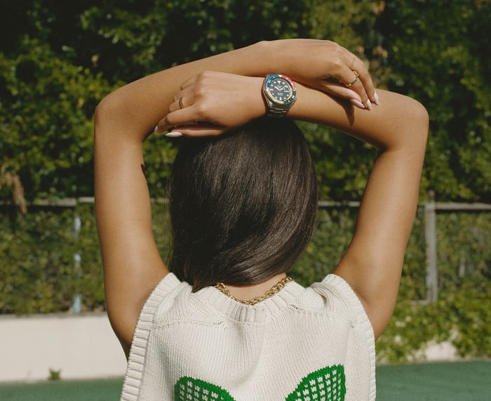 The back of a woman with a Seiko watch